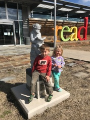 Liam and Cora Jean posing outside the H. Clinton Children's Library