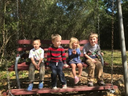 Liam, Gabe, CJ, and Jake taking a break on our nature walk