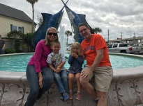 Cindy and John posing with the kids at Kemah Boardwalk