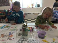 Liam and CJ working on their own art